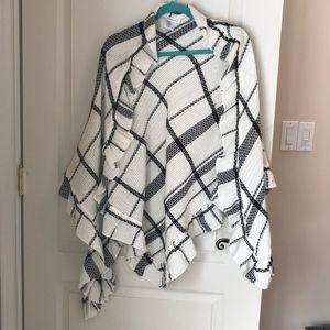 Knitted black and white shrug.